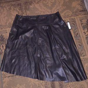 Faux leather sexy asymmetrical skirt 🍾